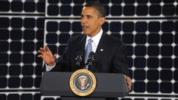 obama doubles renewable energy funding in front of solar panels